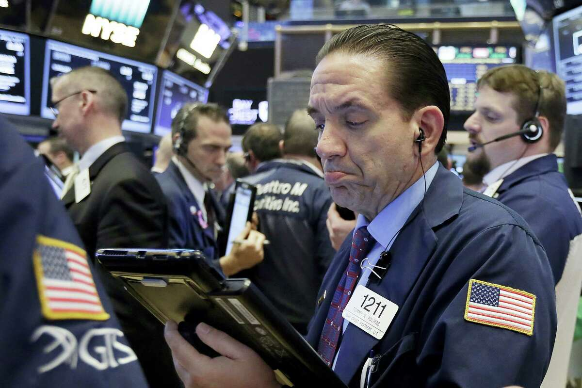 Trader Tommy Kalikas works on the floor of the New York Stock Exchange Thursday.