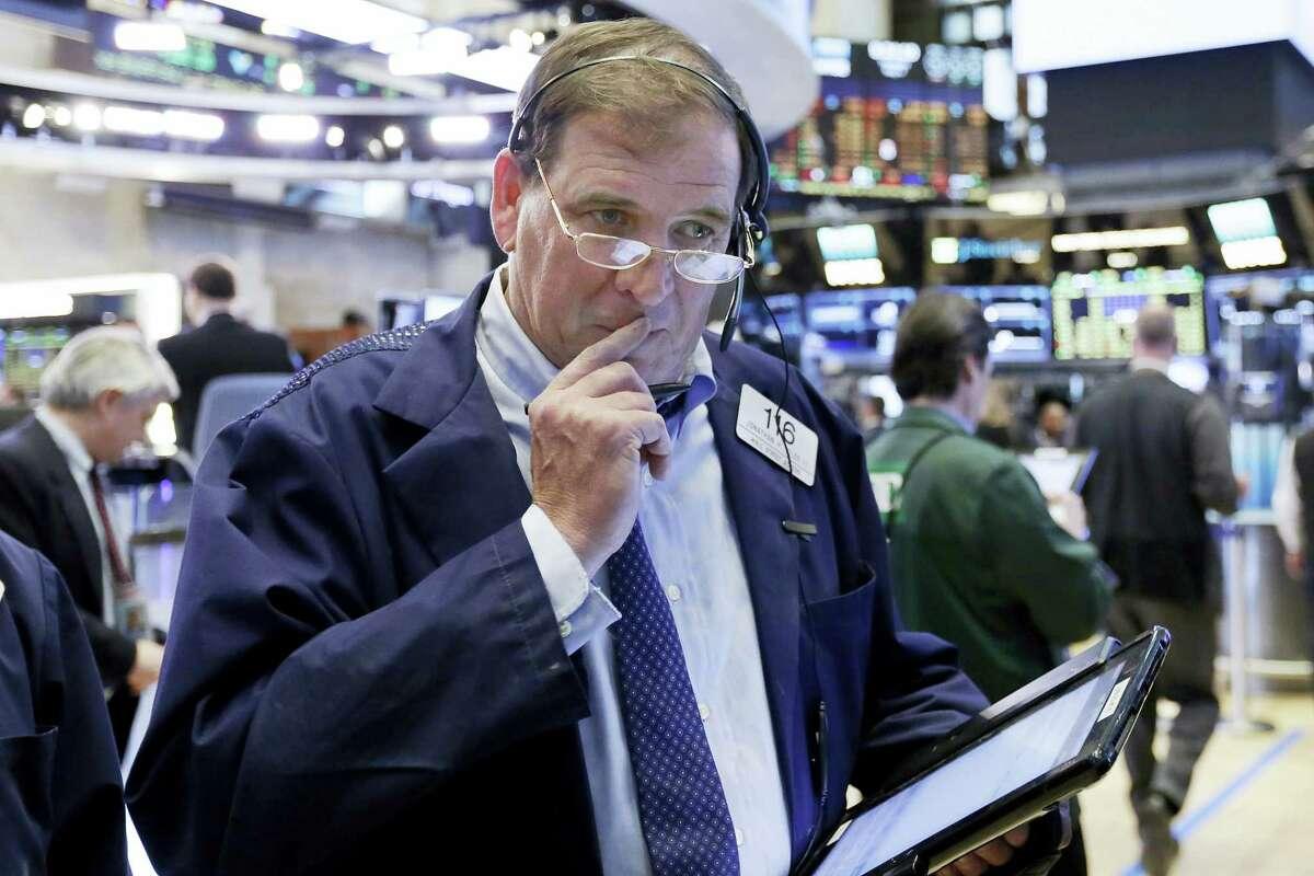 Trader Jonathan Niles works on the floor of the New York Stock Exchange Thursday.