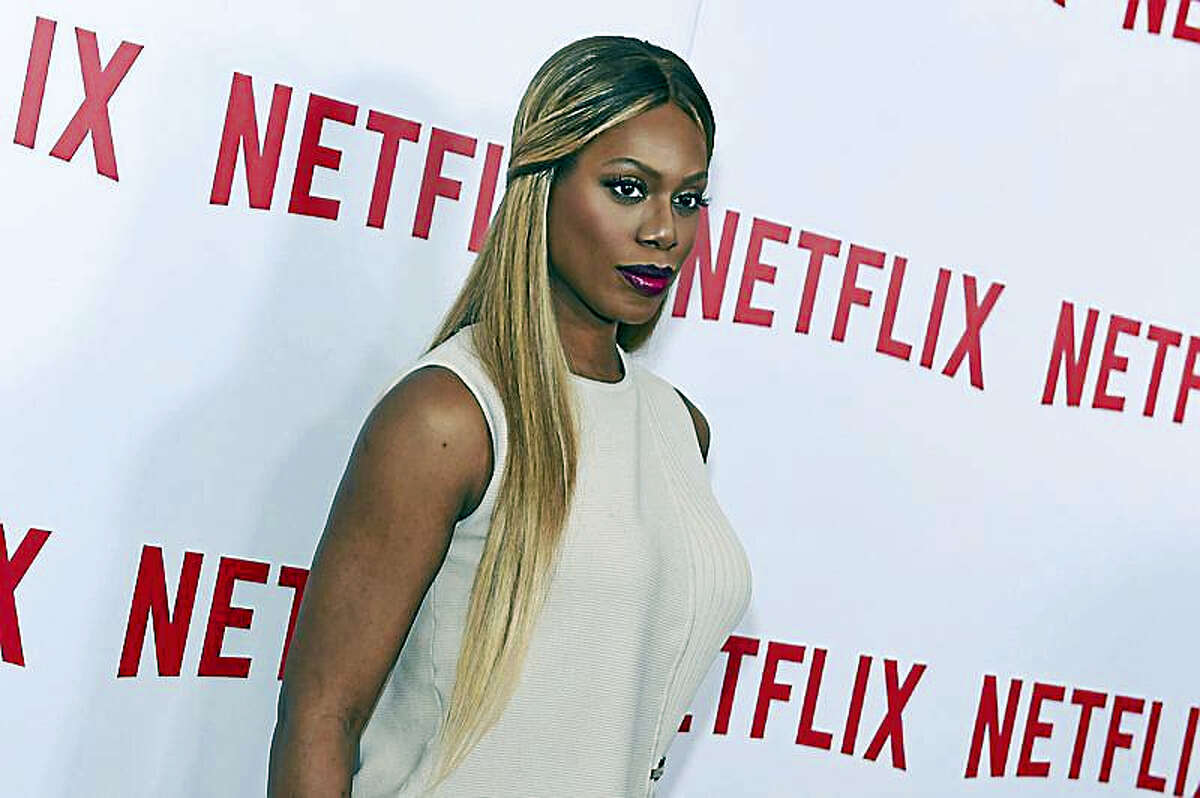 """In this Aug. 11, 2015, file photo, actress Laverne Cox attends the """"Orange Is the New Black"""" FYC Screening at DGA Theater in New York. A hacker claims to have stolen the upcoming season of Netflix's hit series """"Orange Is The New Black,"""" and is demanding that the video streaming service pay an unspecified ransom to prevent all the new episodes from being prematurely released online. New episodes of """"Orange"""" are scheduled for official release on June 9, 2017."""