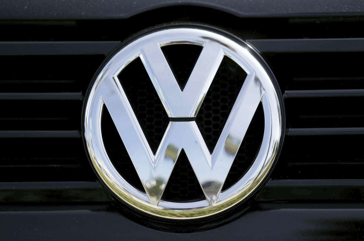 In this Sept. 21, 2015 photo, a Volkswagen logo is seen on car offered for sale at New Century Volkswagen dealership in Glendale, Calif. The Volkswagen executive, Oliver Schmidt, who once was in charge of complying with U.S. emissions regulations has been arrested in connection with the company's emissions-cheating scandal, a person briefed on the matter said Monday, Jan. 9, 2017.