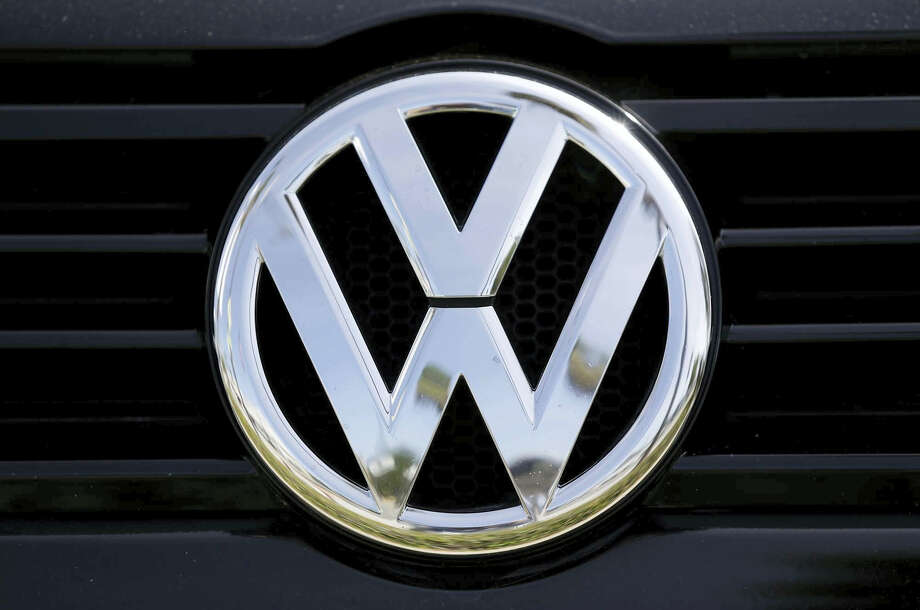 In this Sept. 21, 2015 photo, a Volkswagen logo is seen on car offered for sale at New Century Volkswagen dealership in Glendale, Calif. The Volkswagen executive, Oliver Schmidt, who once was in charge of complying with U.S. emissions regulations has been arrested in connection with the company's emissions-cheating scandal, a person briefed on the matter said Monday, Jan. 9, 2017. Photo: AP Photo/Damian Dovarganes, File  / Copyright 2016 The Associated Press. All rights reserved.