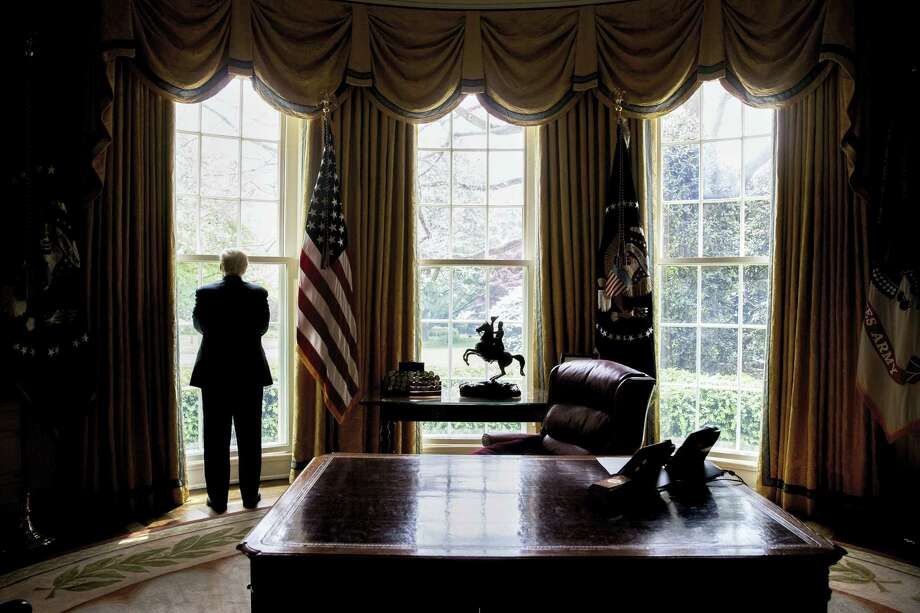 President Donald Trump looks out an Oval Office window at the White House in Washington following an interview with The Associated Press. Photo: Associated Press — Andrew Harnik  / Copyright 2017 The Associated Press. All rights reserved.