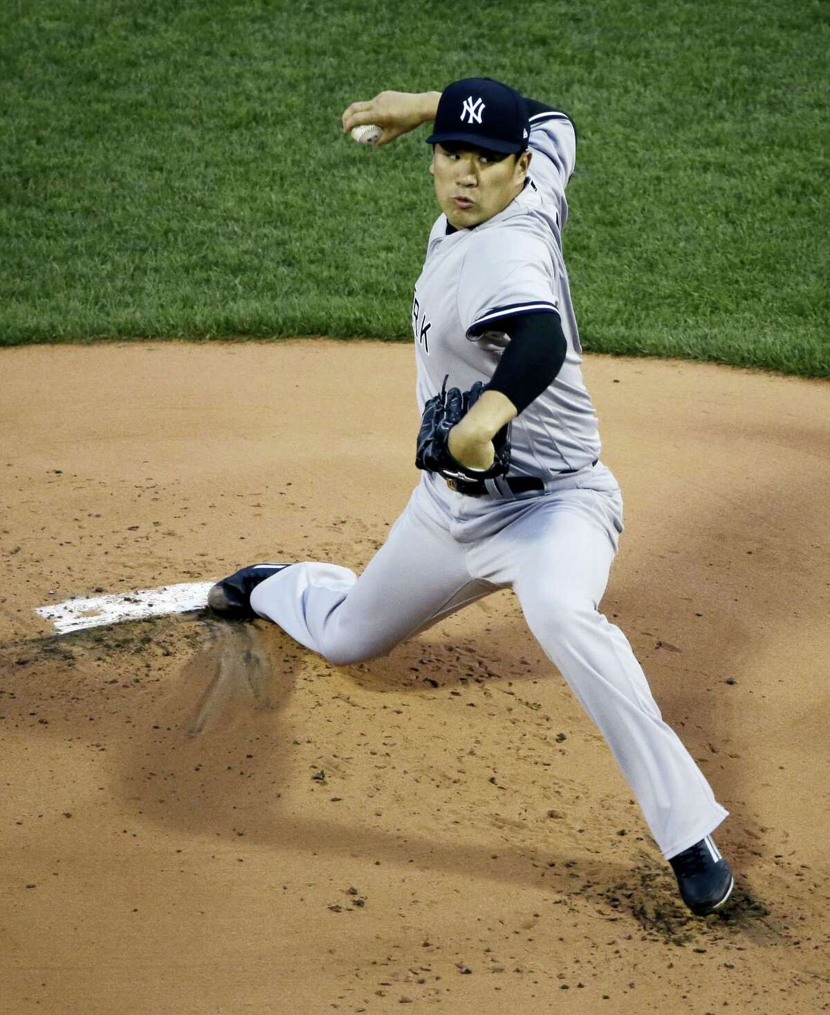 New York Yankees starting pitcher Masahiro Tanaka delivers to the Boston Red Sox during the first inning of a baseball game at Fenway Park, Thursday in Boston.