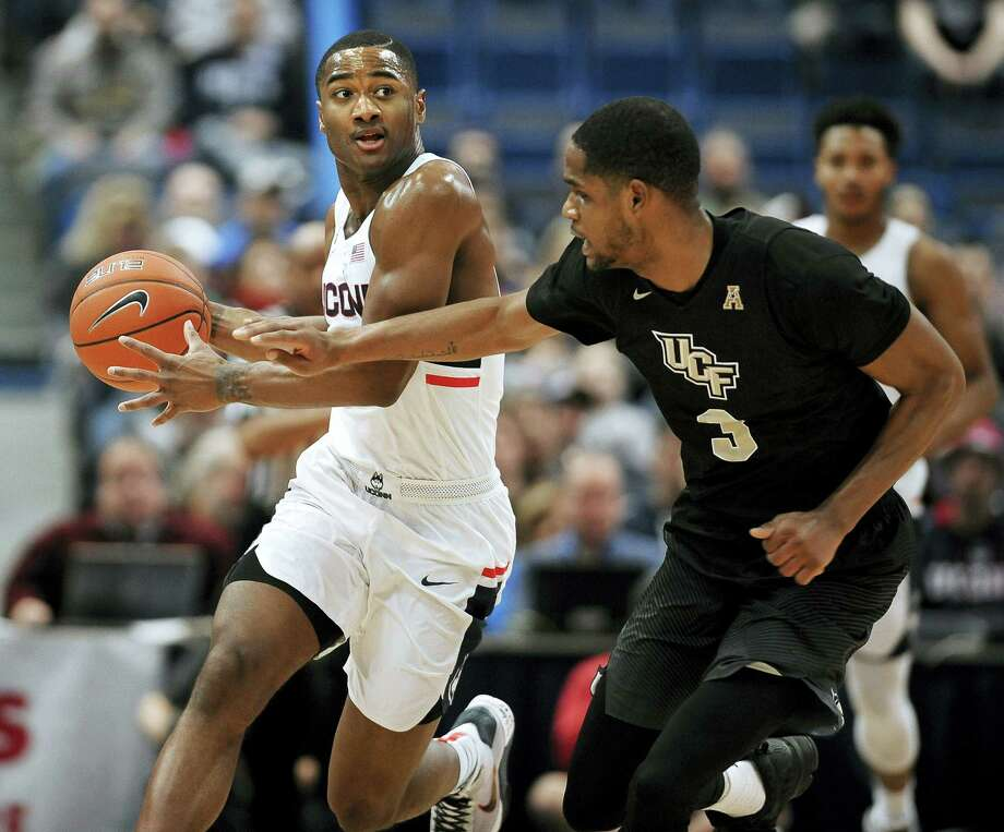 UConn's Rodney Purvis dribbles around Central Florida's A.J. Davis in the first half Sunday. Photo: Jessica Hill — The Associated Press  / AP2017