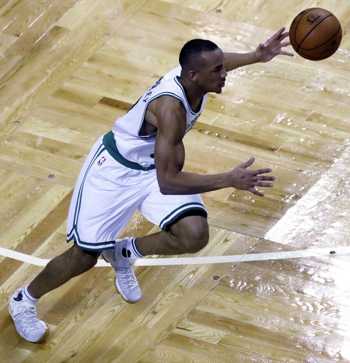 Boston Celtics guard Avery Bradley (0) dribbles down court during the fourth quarter of a first-round NBA playoff basketball game in Boston, Wednesday. The Celtics defeated the Bulls 108-97.