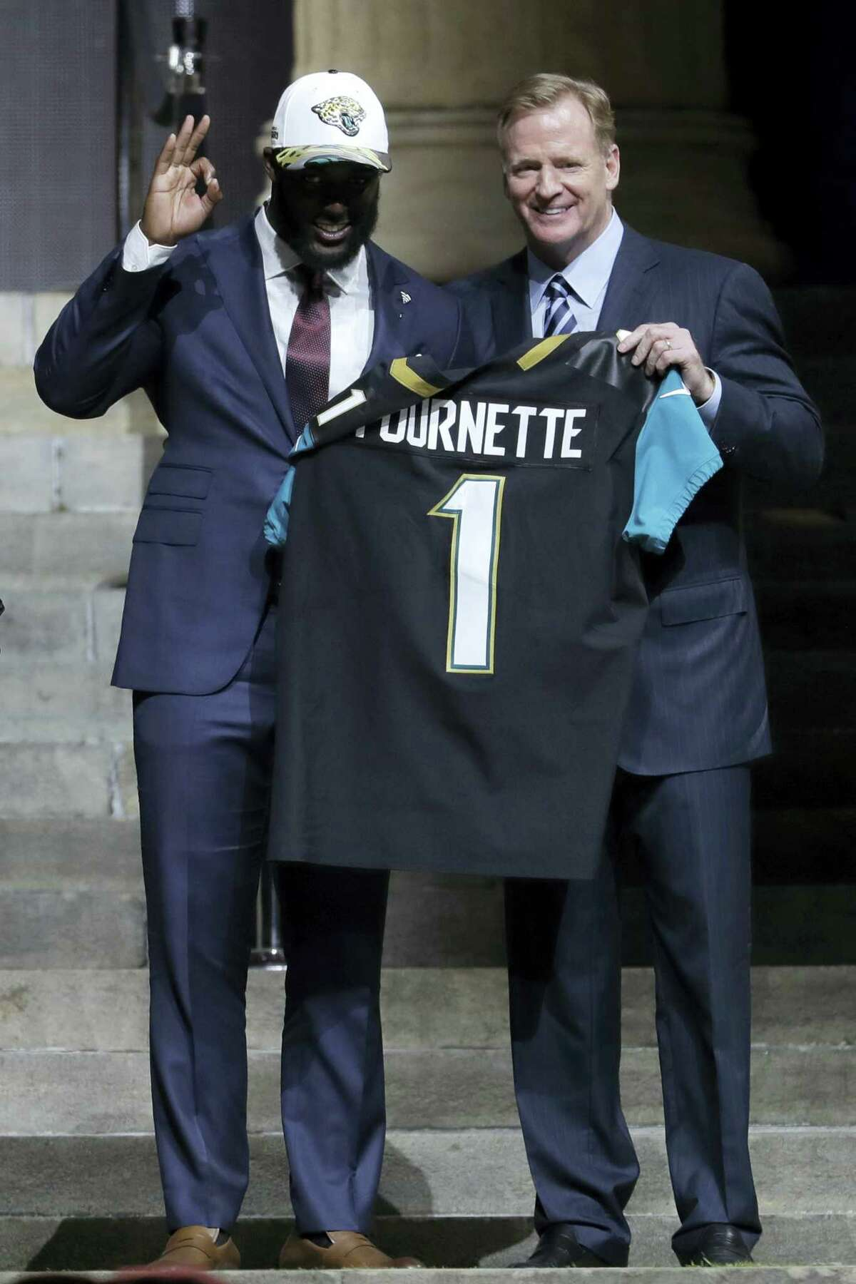 LSU's Leonard Fournette, left, poses with NFL commissioner Roger Goodell after being selected by the Jacksonville Jaguars during the first round of the 2017 NFL football draft, Thursday, April 27, 2017, in Philadelphia. (AP Photo/Julio Cortez)