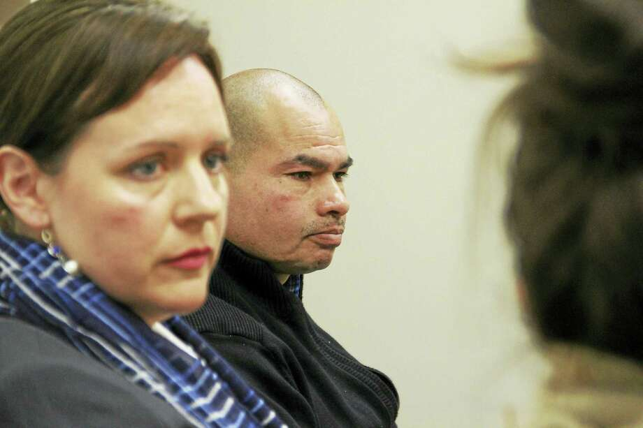 Luis Barrios during a recent interview at the New Haven Register offices in New Haven. Barrios' attorney, Erin O'Neil-Baker, can be seen in the foreground. Photo: Esteban L. Hernandez — New Haven Register FILE PHOTO