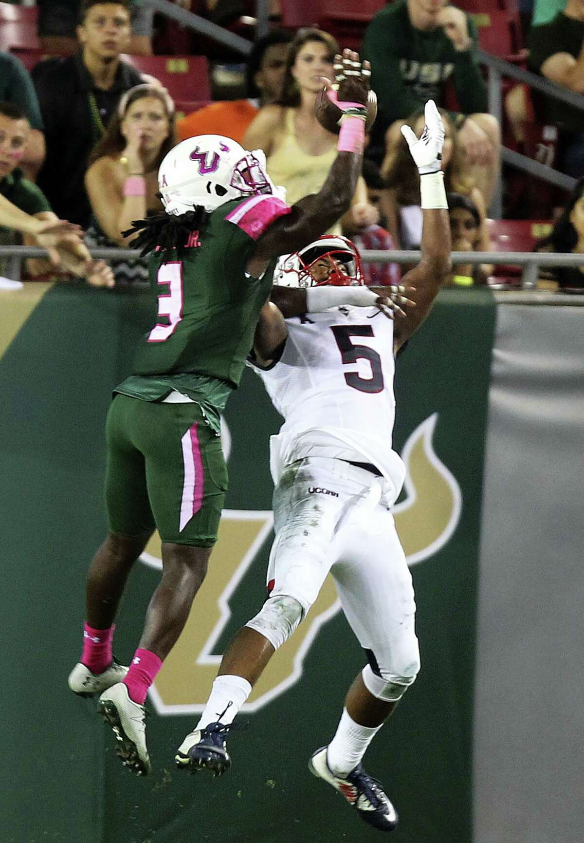 South Florida Bulls cornerback Deatrick Nichols (3) breaks up a pass to Connecticut wide receiver Noel Thomas (5) in the second half of an NCAA college football game in Tampa, Fla., on Oct. 15, 2016.