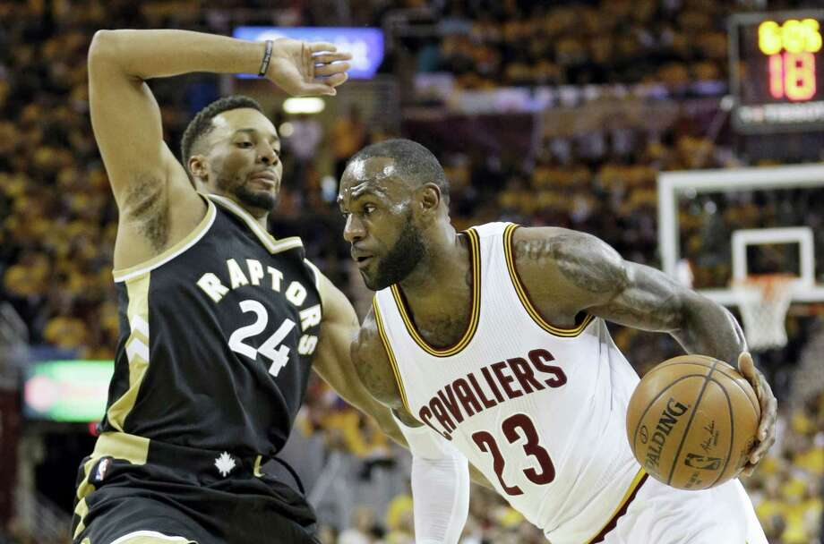 Cleveland'S LeBron James drives against Toronto'S Norman Powell (24) duringd the first half in Game 2 of a second-round NBA basketball playoff series Wednesday. The Cavaliers won 125-103. Photo: TONY DEJAK — THE ASSOCIATED PRESS  / AP 2016
