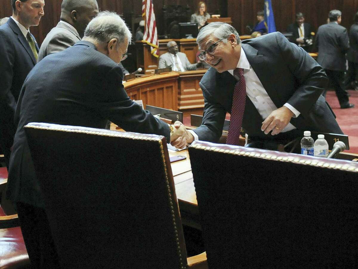 Senate Republican President Pro Tempore Len Fasano, R-North Haven, greets Senate President Pro Tempore Martin M. Looney, D-New Haven, right, during the opening session at the state Capitol on Jan. 4, 2017 in Hartford, Conn.