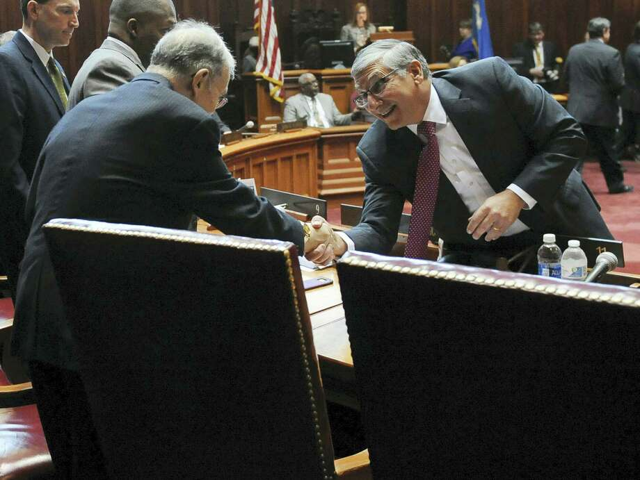 Senate Republican President Pro Tempore Len Fasano, R-North Haven, greets Senate President Pro Tempore Martin M. Looney, D-New Haven, right, during the opening session at the state Capitol on Jan. 4, 2017 in Hartford, Conn. Photo: AP Photo/Jessica Hill  / AP2017
