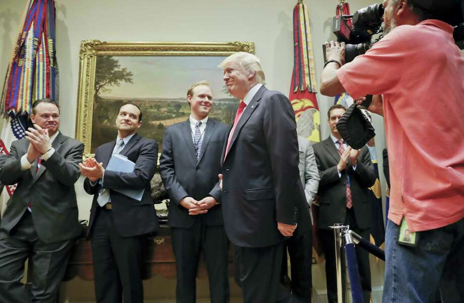 President Donald Trump arrives in the Roosevelt Room of the White House in Washington, Friday, April 28, 2017, while being introduced by Vice President Mike Pence, to sign an Executive Order directing the Interior Department to begin review of restrictive drilling policies for the outer-continental shelf. Photo: AP Photo/Pablo Martinez Monsivais   / Copyright 2017 The Associated Press. All rights reserved.