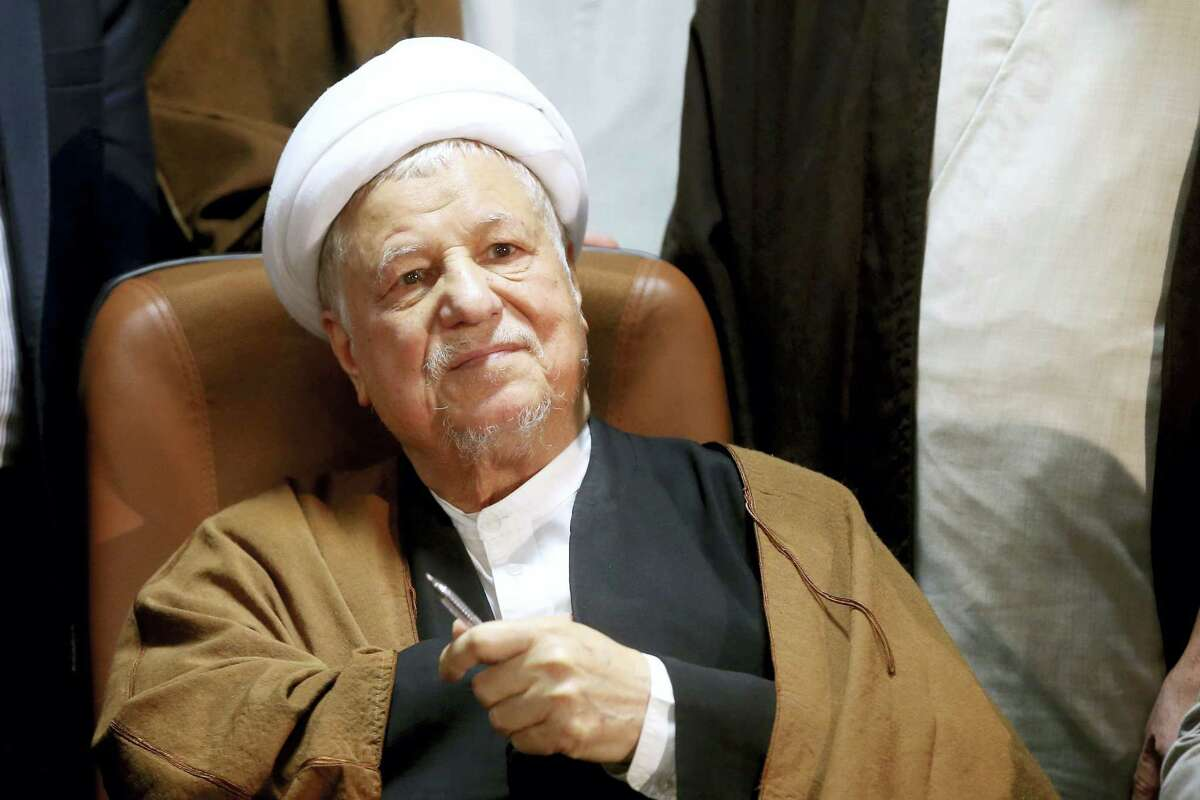 In this Dec. 21, 2015 photo, former Iranian President Akbar Hashemi Rafsanjani, registers his candidacy for the elections of the Experts Assembly in Tehran, Iran. Iranian state media said Sunday, Jan. 8, 2017 that influential former President Akbar Hashemi Rafsanjani has died at age 82 after having been hospitalized because of a heart condition. Rafsanjani, who served as president from 1989 to 1997, was a leading politician who often played kingmaker in the country's turbulent politics. He supported President Hassan Rouhani.