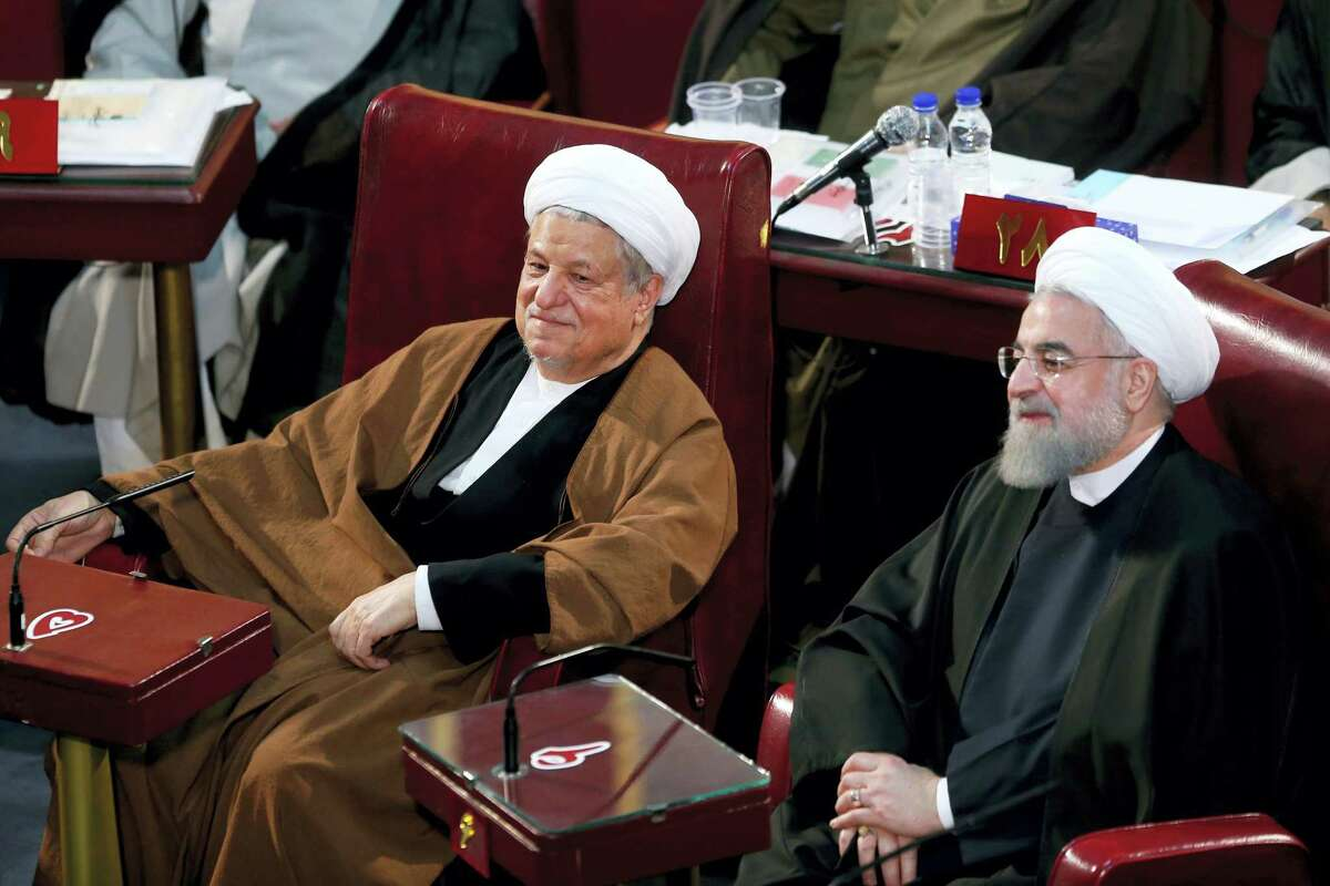 In this March 8, 2016 photo, Iranian President Hassan Rouhani, right, and former President Akbar Hashemi Rafsanjani, left, who are members of the Assembly of Experts, attend an assembly in Tehran, Iran. Iranian state media said Sunday, Jan. 8, 2017 that Rafsanjani has died at age 82 after having been hospitalized because of a heart condition.