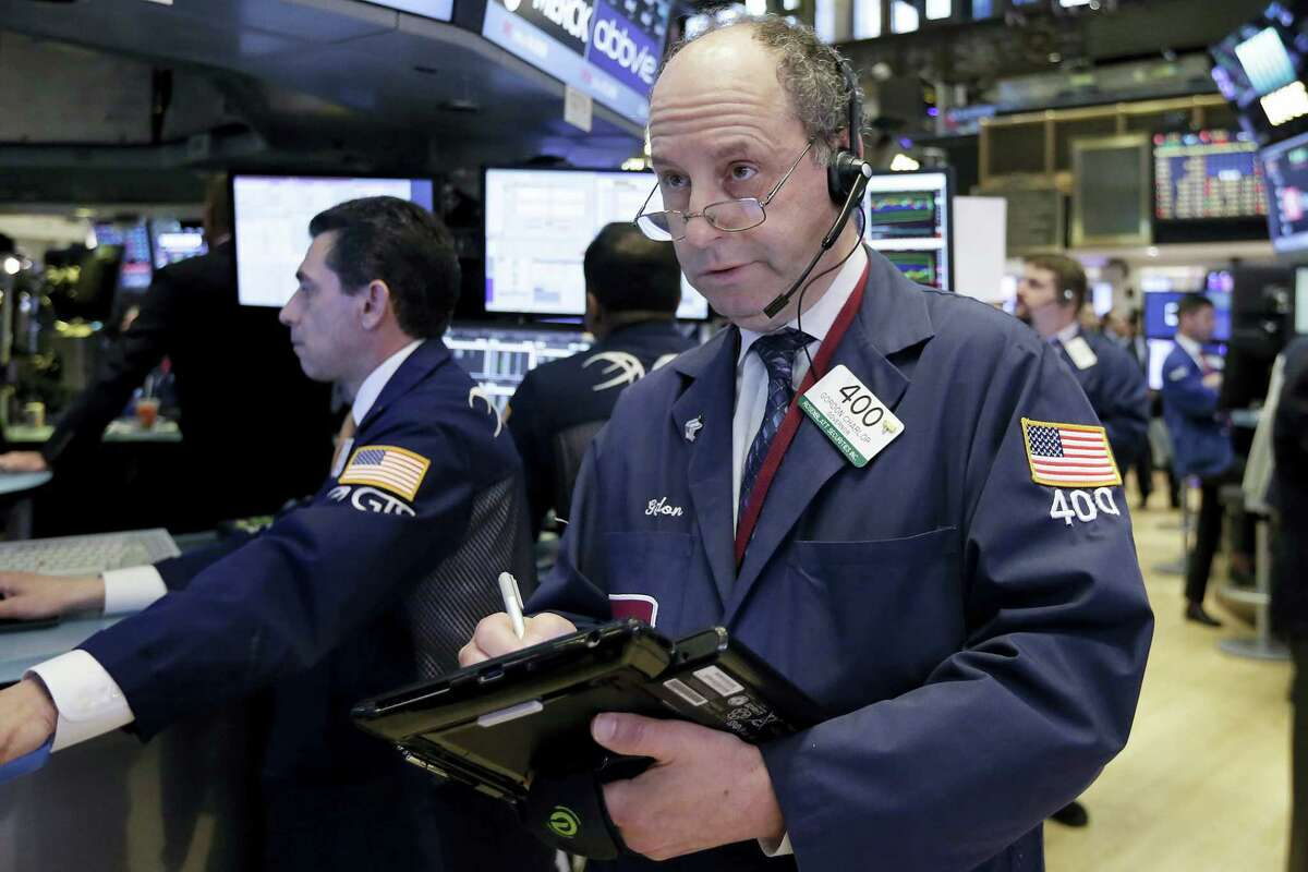 Trader Gordon Charlop works on the floor of the New York Stock Exchange Wednesday.