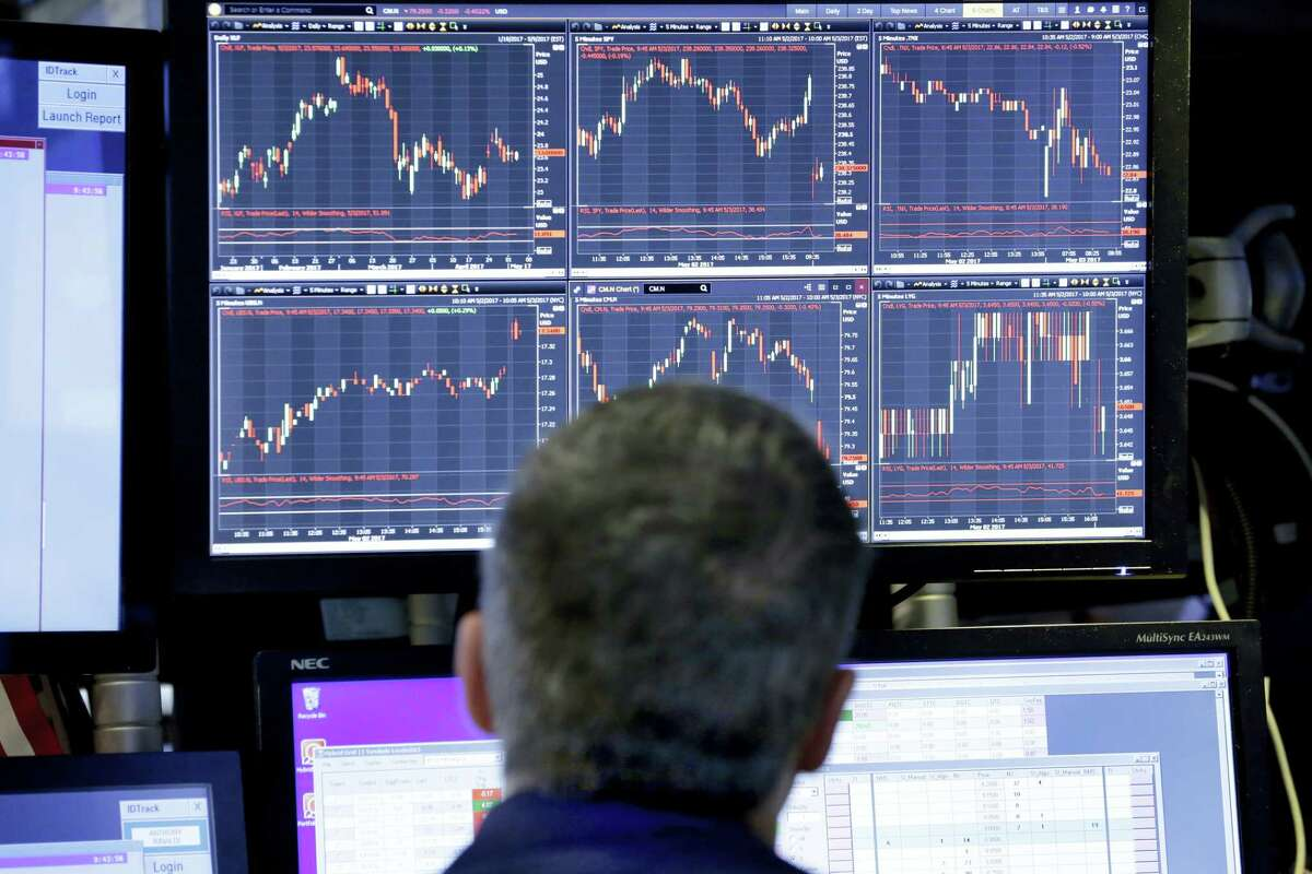 Specialist Anthony Rinaldi works on the floor of the New York Stock Exchange Wednesday.