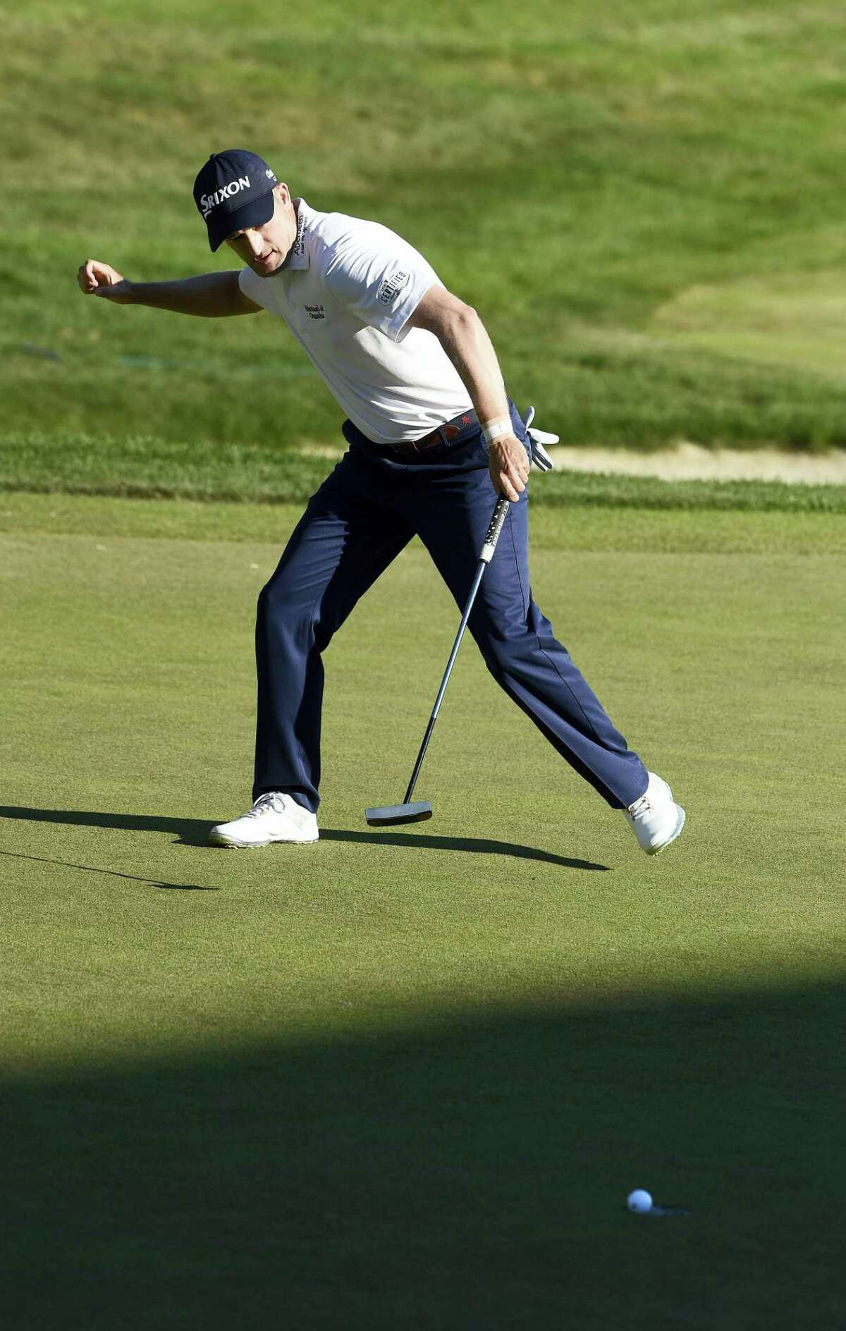 Russell Knox watches as his winning putt falls on the 18th hole during the final round of the Travelers Championship golf tournament in Cromwell last August.