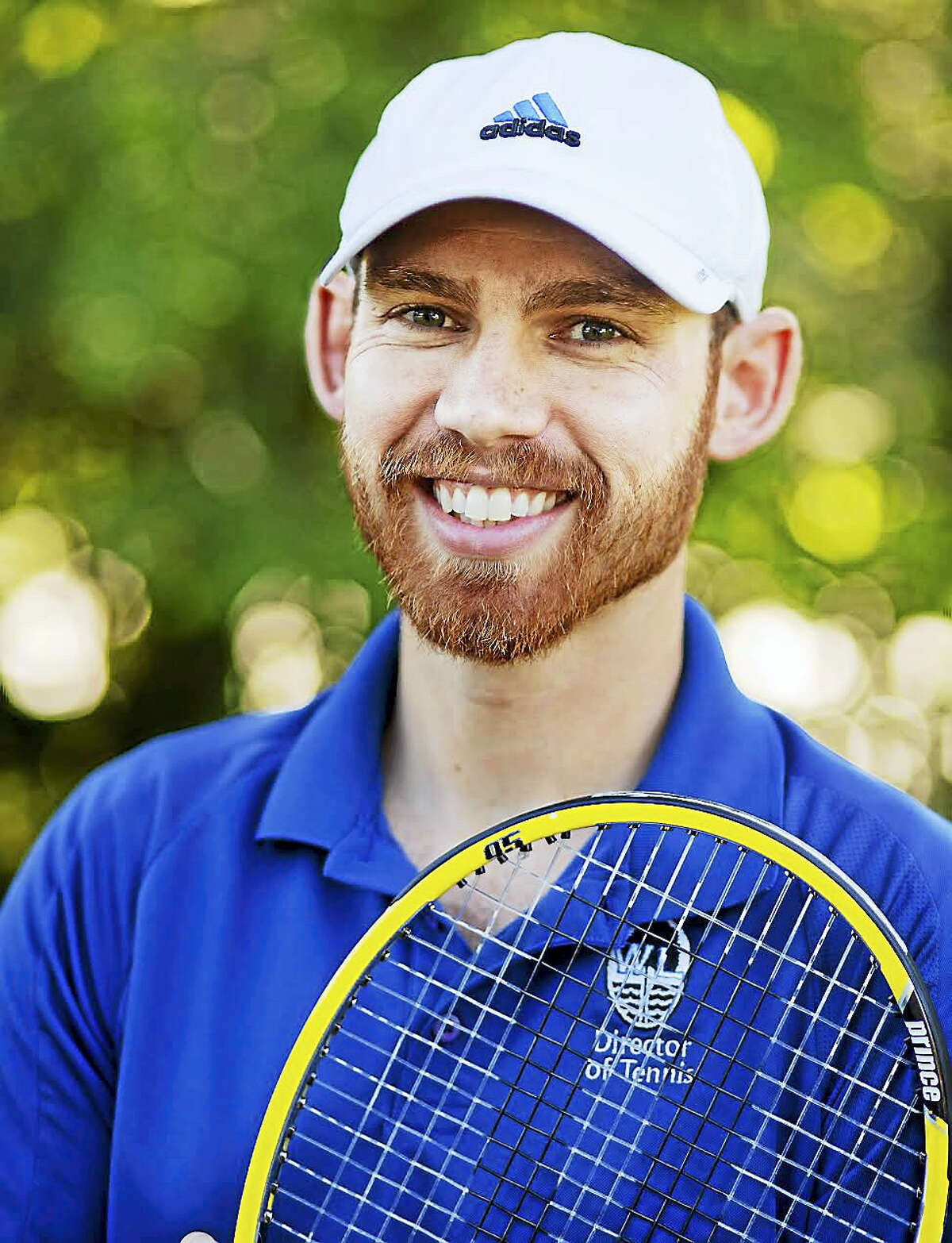 Submitted Photo Northwestern Tennis Coach Mitch Case the Professional Tennis Registry's Connecticut Member of the Year.