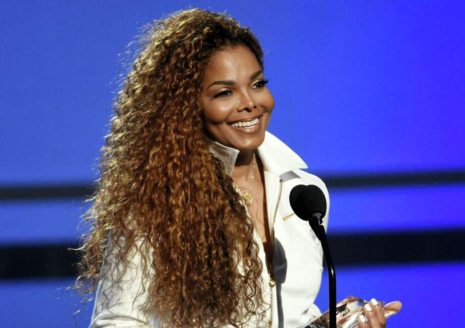 In this June 28, 2015, file photo, Janet Jackson accepts the ultimate icon: music dance visual award at the BET Awards in Los Angeles. In a video posted on her Twitter account May 1, 2017, Jackson confirmed a rumored split with her husband and says plans to resume the world tour she called off more than a year ago during her pregnancy with her son, who was born in January. Photo: Photo By Chris Pizzello/Invision/AP, File   / Invision