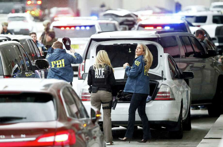 Members of the ATF and FBI arrive at Fort Lauderdale'ÄìHollywood International Airport, Friday, Jan. 6, 2017, in Fort Lauderdale, Fla. A gunman opened fire in the baggage claim area at the airport Friday, killing several people and wounding others before being taken into custody in an attack that sent panicked passengers running out of the terminal and onto the tarmac, authorities said. Photo: AP Photo/Wilfredo Lee   / Copyright 2017 The Associated Press. All rights reserved.