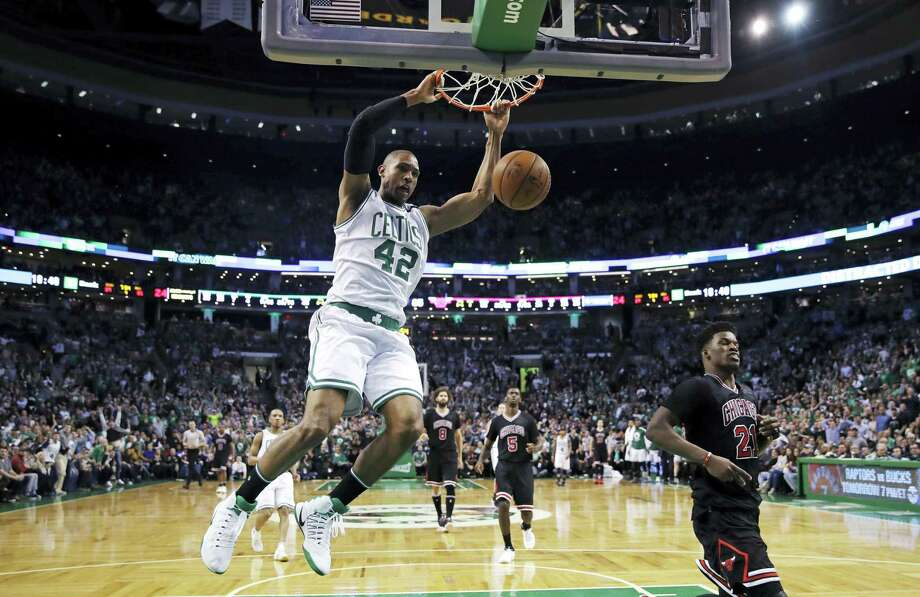 Boston Celtics center Al Horford (42) slams a dunk against the Chicago Bulls during the fourth quarter of a first-round NBA playoff basketball game in Boston, Wednesday. The Celtics defeated the Bulls 108-97. Photo: Charles Krupa — The Associated Press  / Copyright 2017 The Associated Press. All rights reserved.