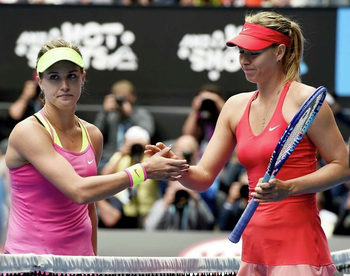 In this Jan. 27, 2015 photo, Maria Sharapova, of Russia right, is congratulated by Eugenie Bouchard, of Canada, after winning their quarterfinal match at the Australian Open tennis championship in Melbourne, Australia. The 2014 Wimbledon finalist from Canada called Sharapova a cheater upon the Russian's return from a 15-month doping suspension for using the banned substance meldonium.