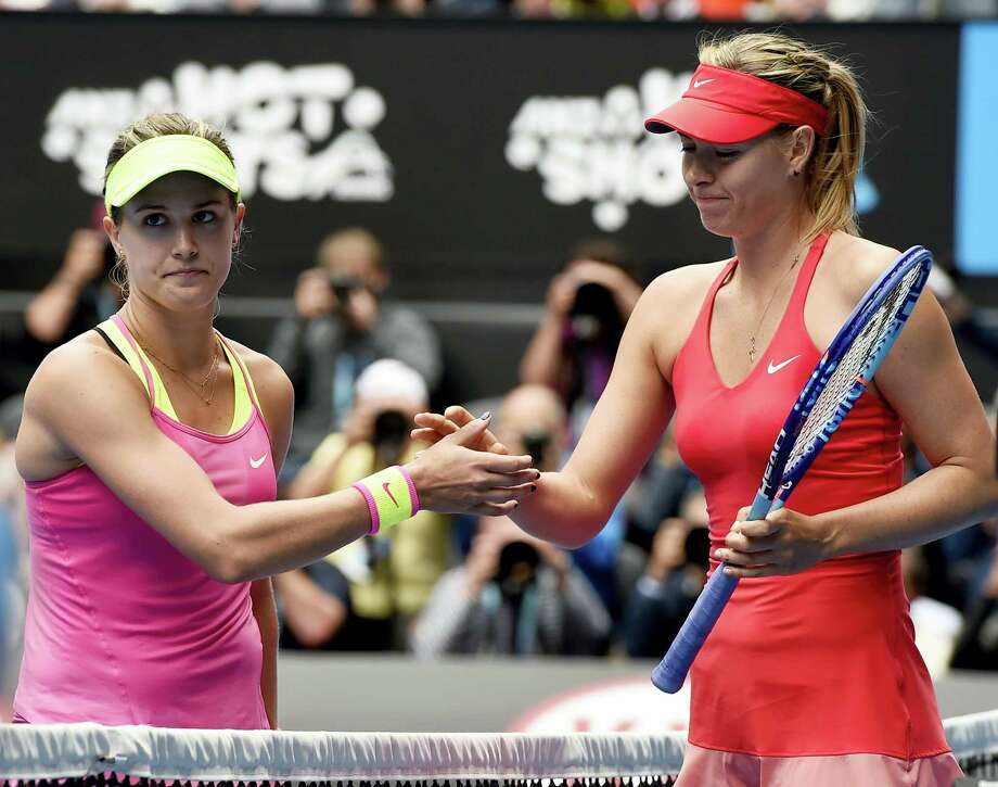In this Jan. 27, 2015 photo, Maria Sharapova, of Russia right, is congratulated by Eugenie Bouchard, of Canada, after winning their quarterfinal match at the Australian Open tennis championship in Melbourne, Australia. The 2014 Wimbledon finalist from Canada called Sharapova a cheater upon the Russian's return from a 15-month doping suspension for using the banned substance meldonium. Photo: AP Photo — Andy Brownbill, File  / Copyright 2017 The Associated Press. All rights reserved.