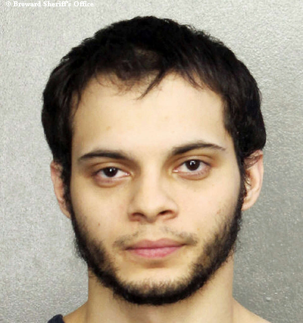 This booking photo provided by the Broward Sheriff's Office shows suspect Esteban Ruiz Santiago, 26, Saturday, Jan. 7, 2017, in Fort Lauderdale, Fla.