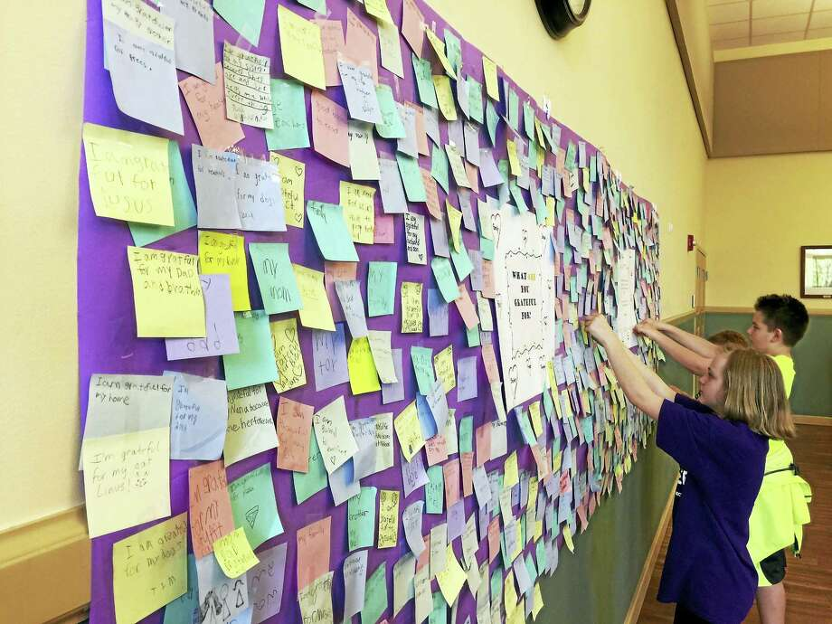 Southwest School students put a banner marking thoughts of gratitude on display in the Torrington City Hall Tuesday. Photo: Ben Lambert — The Register Citizen