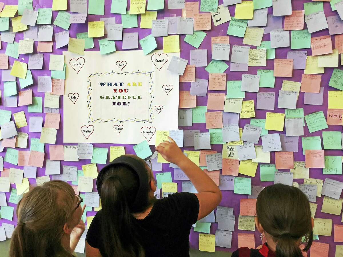 Southwest School students put a banner marking thoughts of gratitude on display in the Torrington City Hall Tuesday.