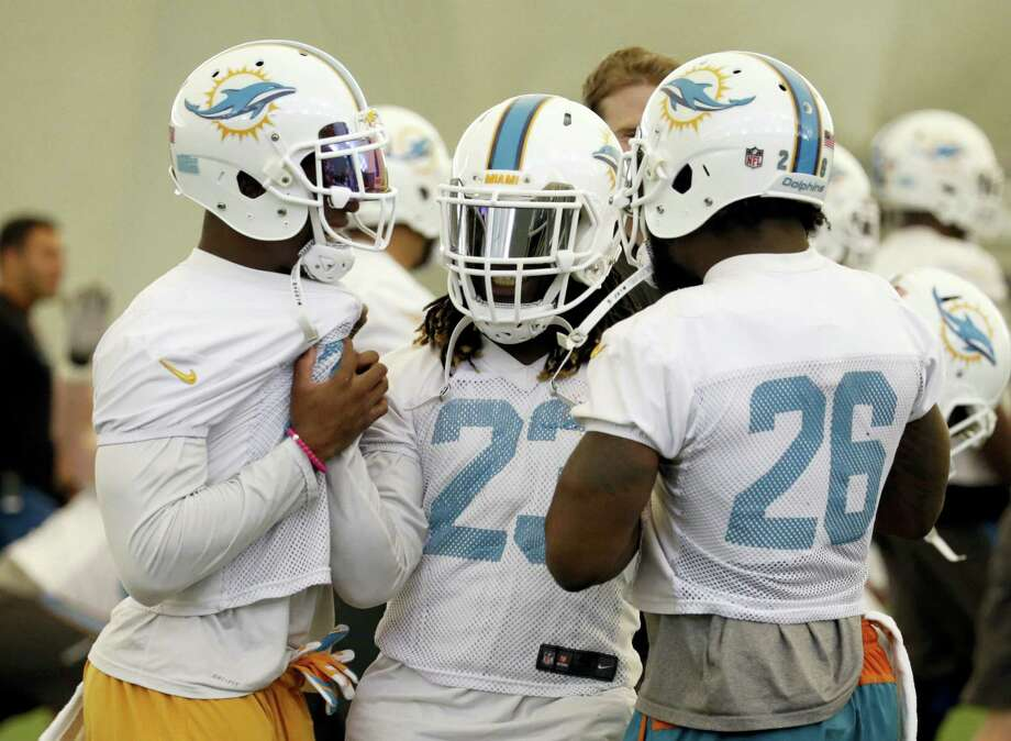 Miami Dolphins running back Jay Ajayi (23) talks with running back Kenyan Drake, left, and running back Damien Williams during a recent practice. Photo: The Associated Press File Photo  / Copyright 2017 The Associated Press. All rights reserved.