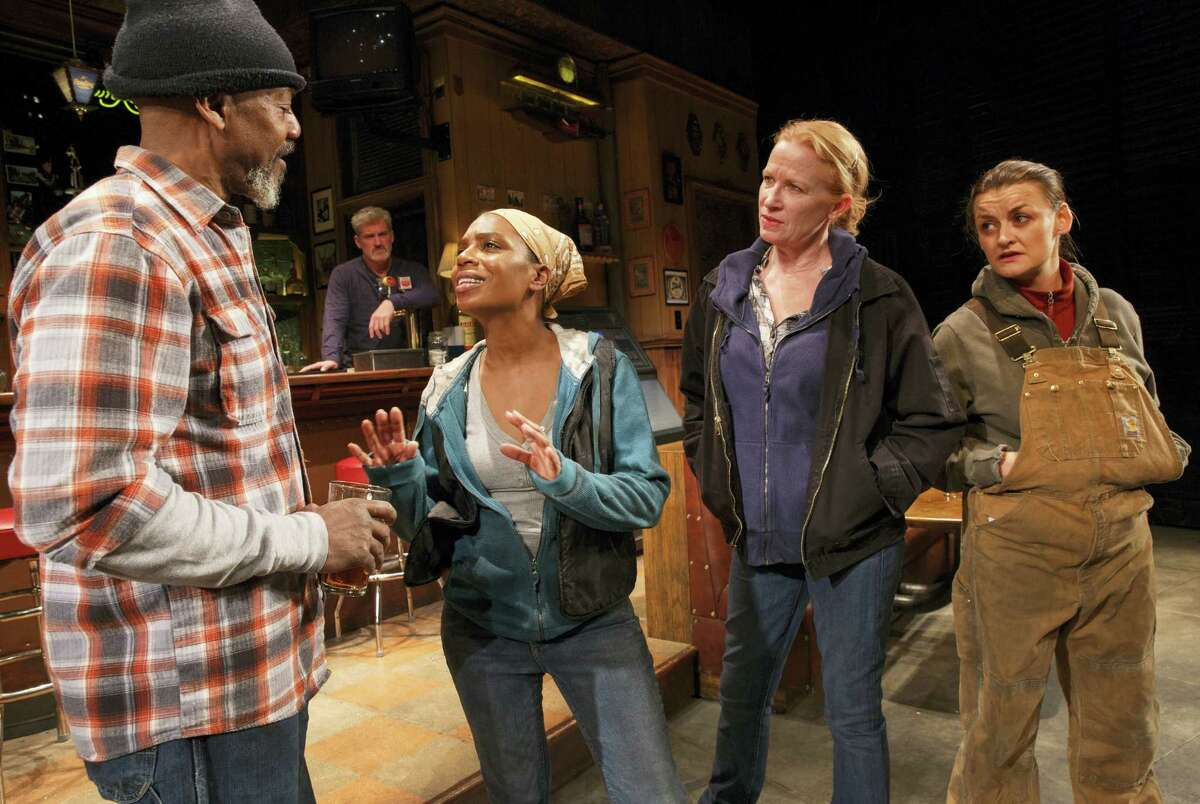 """This image released by Boneau.Bryan-Brown shows, foreground from left, John Earl Jelks, Michelle Wilson, Johanna Day and Alison Wright during a performance of Lynn Nottage's play, """"Sweat,"""" at Studio 54 in New York. The play, which was awarded the Pulitzer Prize for drama on April 10, is a likely contender for a Tony Award for best play. Tony Award nominations will be announced on Tuesday."""