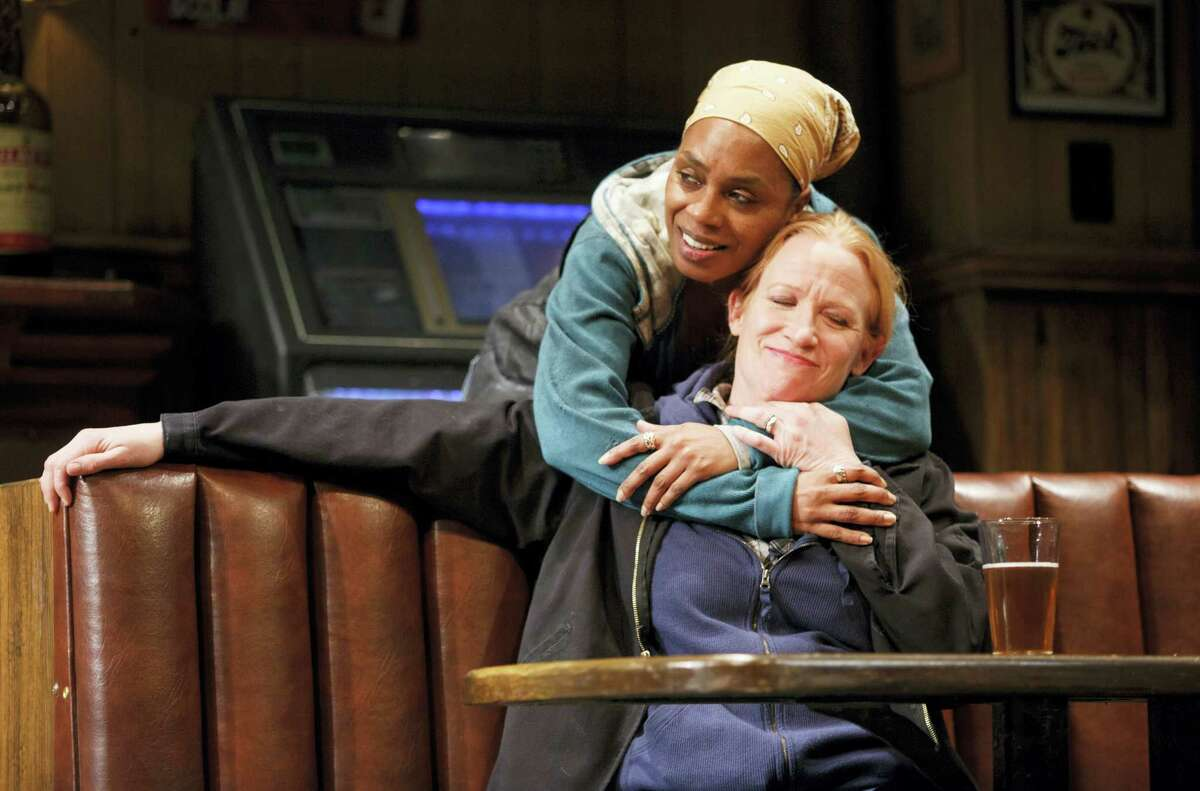 """This image released by Boneau/Bryan-Brown shows, Michelle Wilson, left, and Johanna Day during a performance of Lynn Nottage's play, """"Sweat,"""" at Studio 54 in New York. The play, which was awarded the Pulitzer Prize for drama on April 10, is a likely contender for a Tony Award for best play. Tony Award nominations will be announced on Tuesday."""