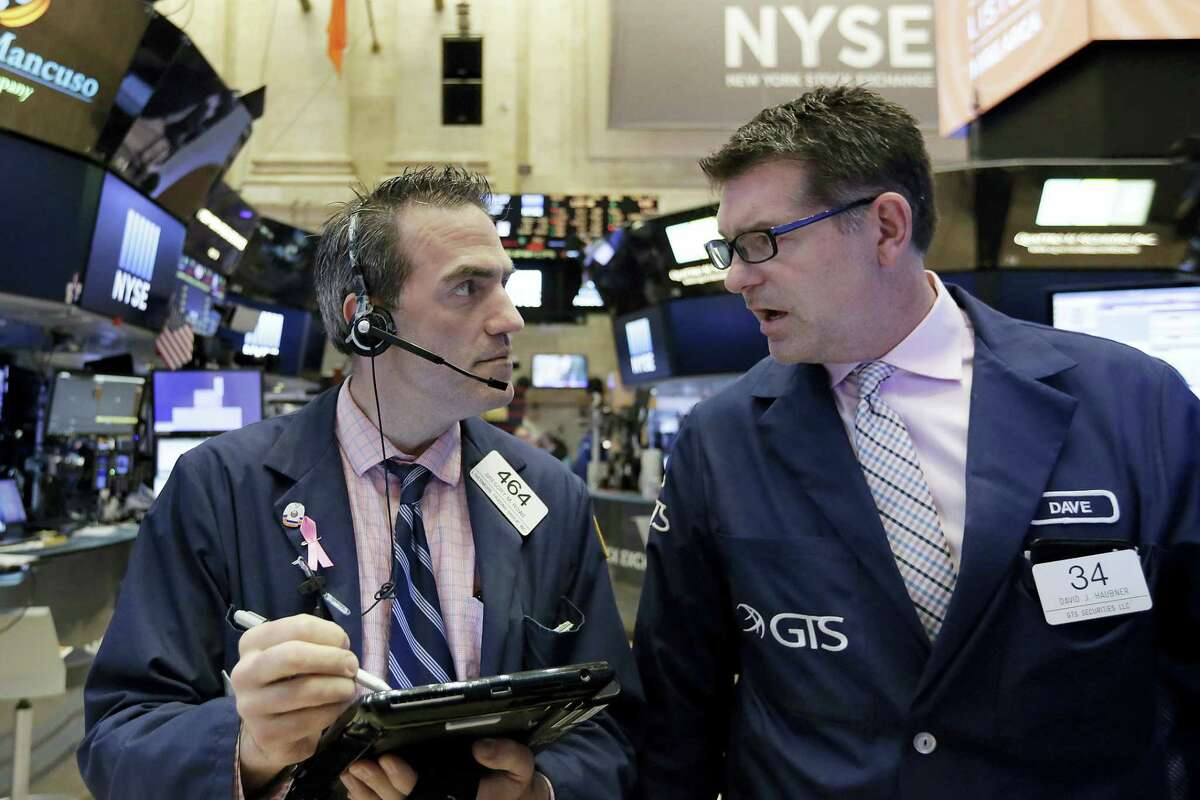 Trader Gregory Roqwe, left, and specialist David Haubner work on the floor of the New York Stock Exchange Tuesday.