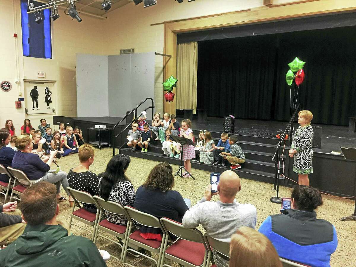 """New Hartford students and community members recited poems with a culinary theme during a launch for """"Poetry for the Pantry: Feed A Body, Feed Your Soul."""""""