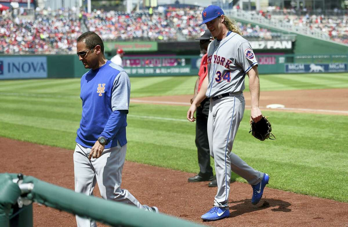 New York Mets starting pitcher Noah Syndergaard (34) leaves a baseball game with an injury during the second inning against the Washington Nationals, Sunday in Washington.
