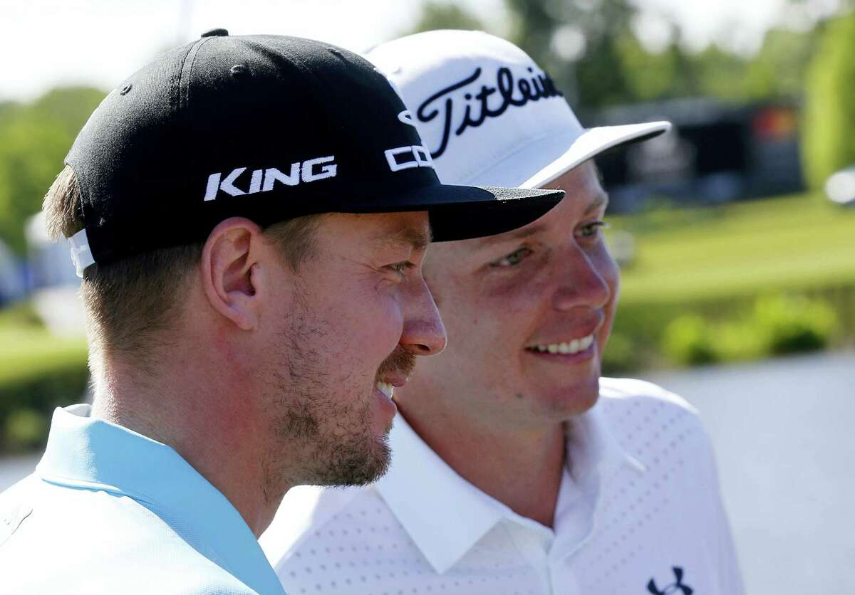 Jonas Blixt, of Sweden, left, and teammate Cameron Smith, of Australia, talk to reporters after Smith sank his birdie putt on the 18th green to win a sudden-death playoff for the PGA Zurich Classic golf tournament's new two-man team format at TPC Louisiana in Avondale, La., Monday. The pair defeated Kevin Kisner and Scott Brown.