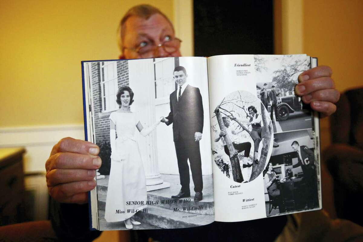 """In this photo taken Dec. 6, 2016, Les Johnson, 69, of Camden, Ala.,, a family friend of Attorney General-designate, Sen. Jeff Sessions, R-Ala. holds up a 1965 year book of Sessions graduating year as the Wilcox County High School's """"Senior High Who's Who, Mr. Wilcox County High,"""" as appearing on the left page, an honor of the high school according to Alford in Camden, Ala."""