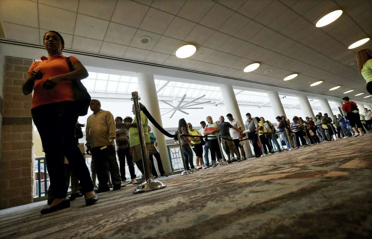 In this Sept. 3, 2014, file photo, people wait in line to sign up for unemployment in Atlantic City, N.J. The proportion of men in their prime working years who have a job has been steadily declining _ and holding back the United States'Äô growth potential. The full brunt of this 60-year decline became apparent during the 2016 election. Trump won the electoral college in large part by calling for more jobs at steel mills, auto plants and coal mines, the types of work that had once employed legions of men who lacked a college education.