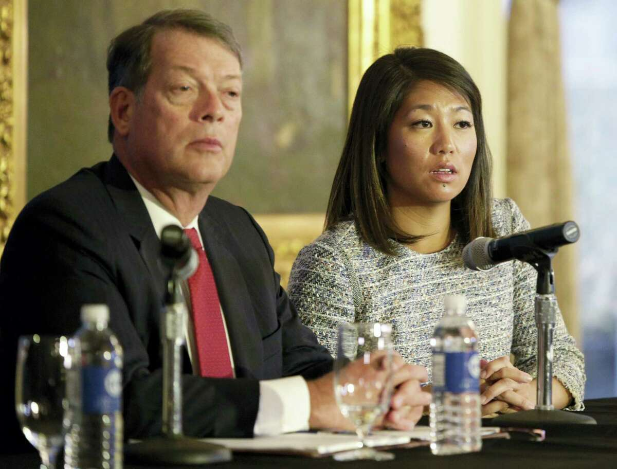 FILE - In this Thursday, April 13, 2017, file photo, Crystal Pepper, daughter of Dr. David Dao, accompanied by attorney Stephen Golan, speaks at a news conference in Chicago. On Thursday, April 27, 2017, United Airlines reached a settlement with Dao, the passenger who was dragged off a United Express flight on April 9, igniting a debate about poor service and a lack of customer-friendly policies on U.S. airlines. United and Dao's lawyers declined to disclose financial terms of the settlement. (AP Photo/Teresa Crawford, File)