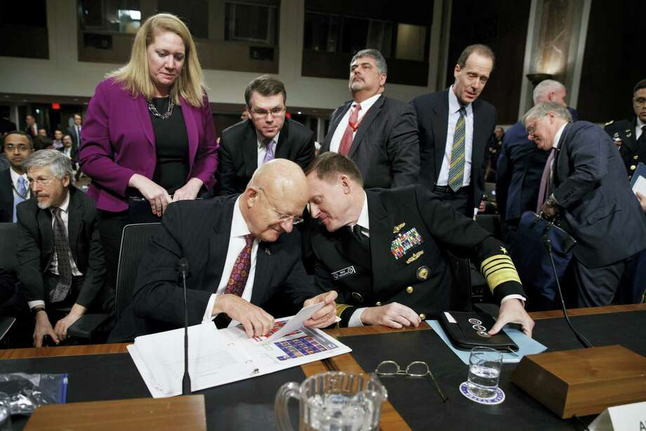 """Director of National Intelligence James Clapper, left, talks with National Security Agency and Cyber Command chief Adm. Michael Rogers on Capitol Hill in Washington, Thursday, Jan. 5, 2017, at the conclusion of a Senate Armed Services Committee hearing: """"Foreign Cyber Threats to the United States."""" Photo: AP Photo/Evan Vucci   / Copyright 2017 The Associated Press. All rights reserved."""