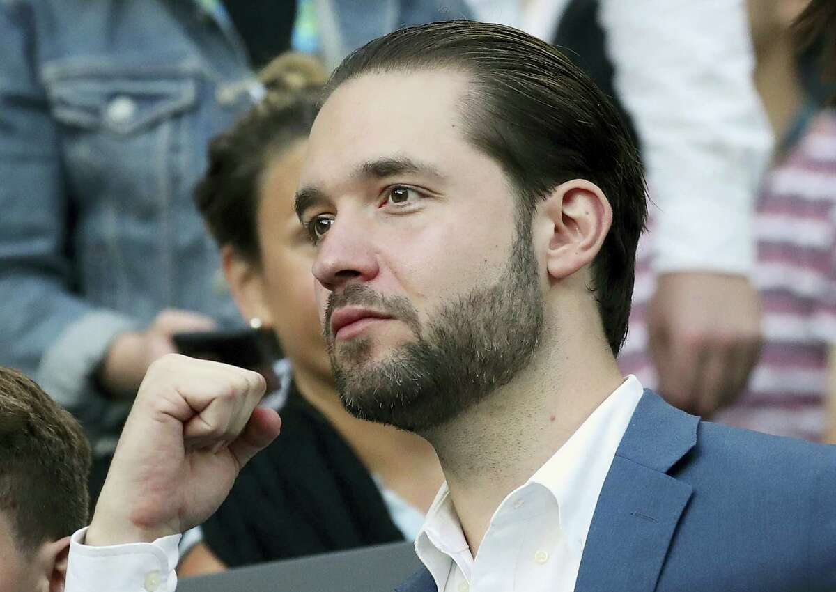 """In this Jan. 28, 2017 photo, Alexis Ohanian, fiance of Serena Williams, watches Williams play her sister, Venus, in the women's singles final at the Australian Open tennis championships in Melbourne, Australia. A spokeswoman for Serena Williams says the tennis star is pregnant. Earlier in the day, Williams posted a photo of herself on the social media site Snapchat with the caption """"20 weeks."""" Williams announced in late December that she was engaged to Reddit co-founder Ohanian."""