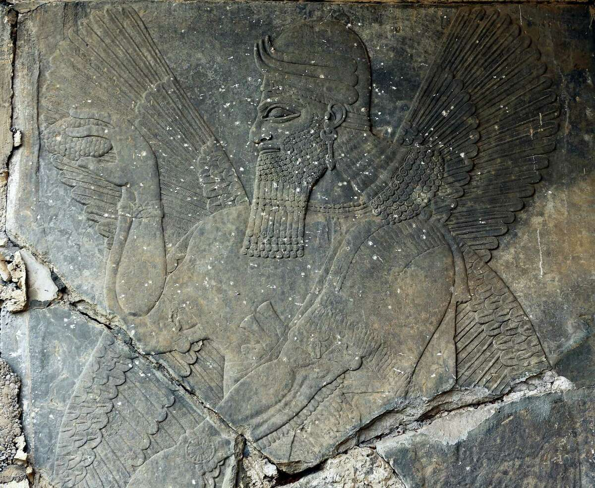 Carved stone slabs that were destroyed by Islamic State group militants are seen at the ancient site of Nimrud some 19 miles (30 kilometers) southeast of Mosul, Iraq in this Wednesday, Nov. 16, 2016, file photo. Militants blew up and hacked apart much of the nearly 3,000-year-old city's remains in 2015, destroying one of the Mideast's most important archaeological sites. More than a month after the extremists were driven out, the site is still in danger, with the wreckage unprotected and vulnerable to being stolen.