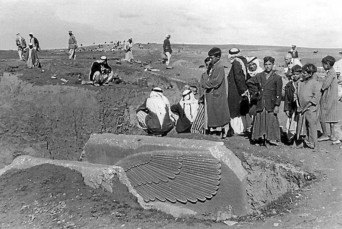 Workers partially unearth a statue of a lamassu, a great winged bull protective deity at the ancient site of Nimrud. British mystery writer Agatha Christie took this and many such photos.