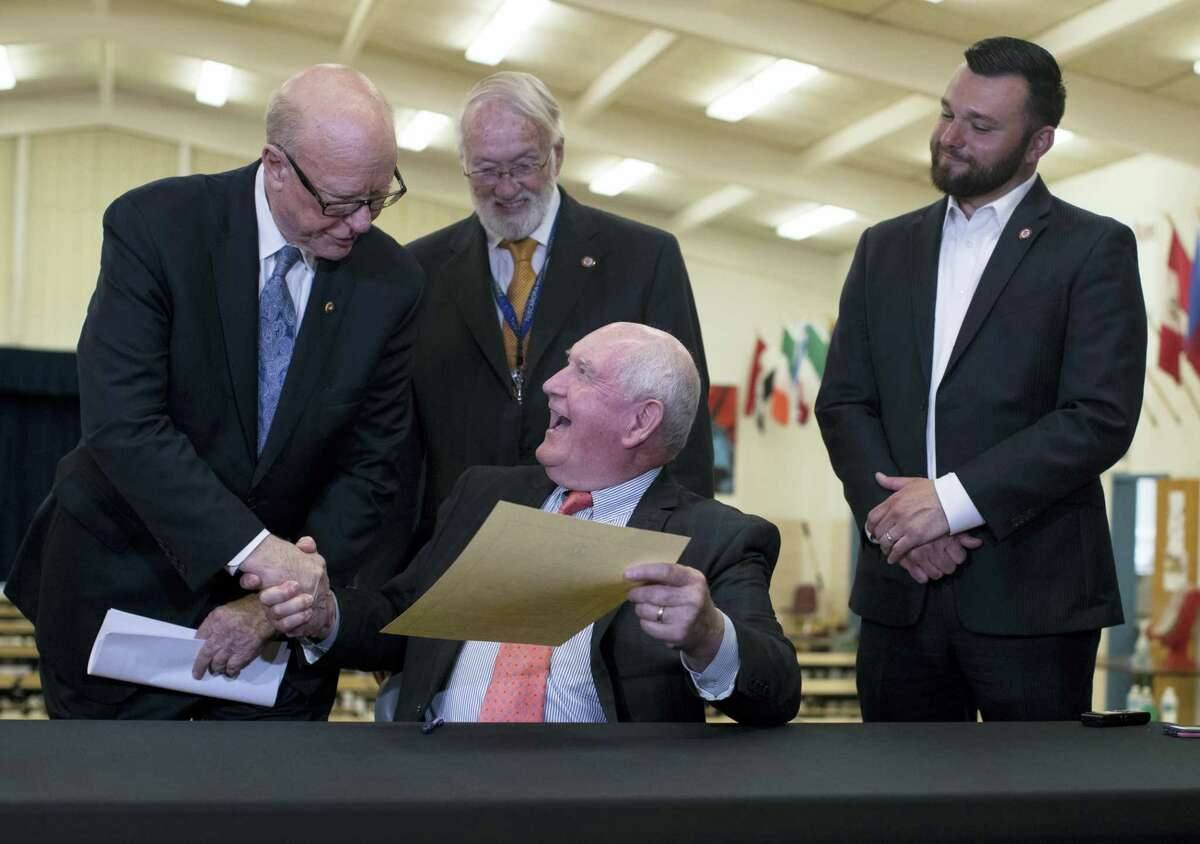 Agriculture Secretary Sonny Perdue shake hands with Senate Agriculture, Nutrition and Forestry Committee Chairman Sen. Pat Roberts, R-Kan., after signing an interim rule designed to provide flexibility for school meals at Catoctin Elementary School in Leesburg, Va., Monday.