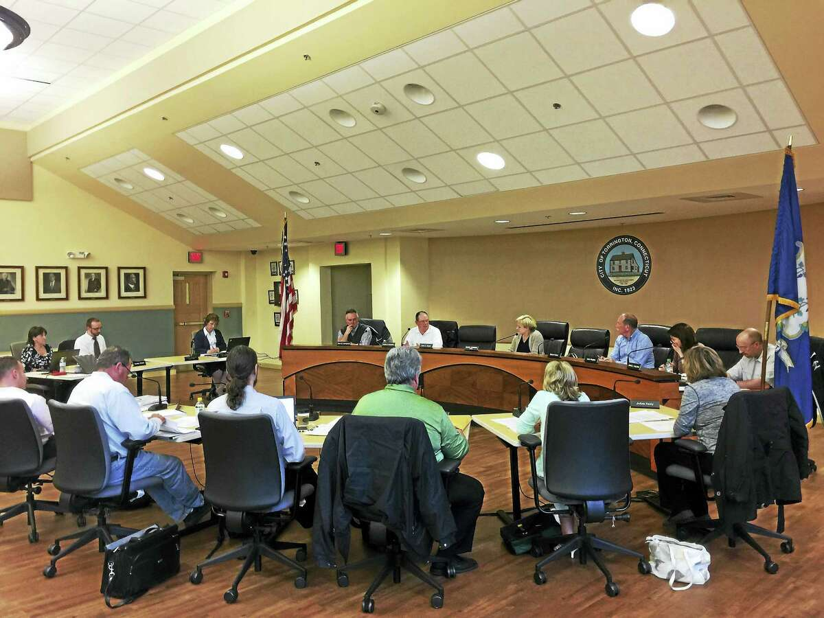 The Board of Finance and City Council discuss the proposed city budget Monday evening.