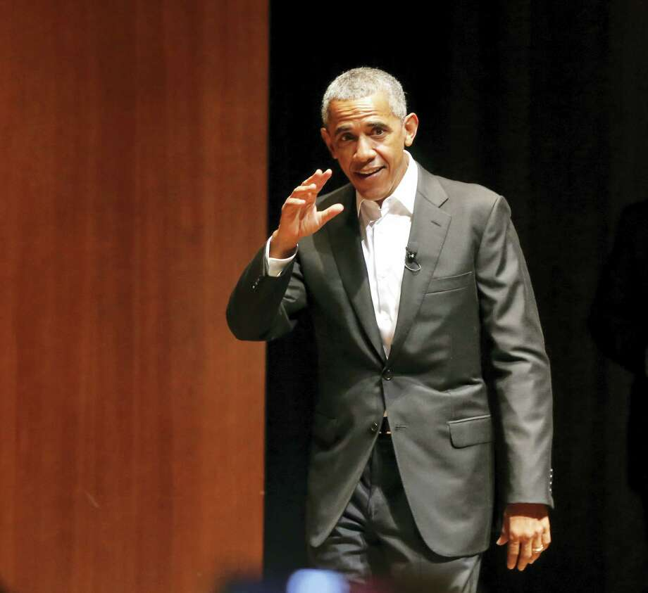 Former President Barack Obama waves as he arrives to host a conversation on civic engagement and community organizing, Monday, April 24, 2017, at the University of Chicago in Chicago. It's the former president's first public event of his post-presidential life in the place where he started his political career. Photo: AP Photo/Charles Rex Arbogast   / Copyright 2017 The Associated Press. All rights reserved.