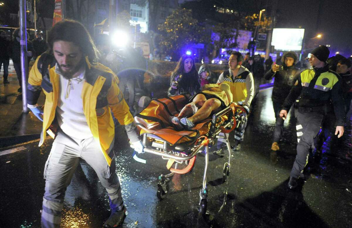 Medics carry a wounded person at the scene after an attack at a popular nightclub in Istanbul.