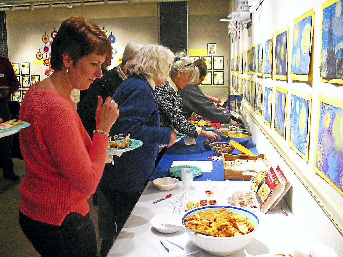 Contributed photoCookbook Club membees try their recipes during a recent program.