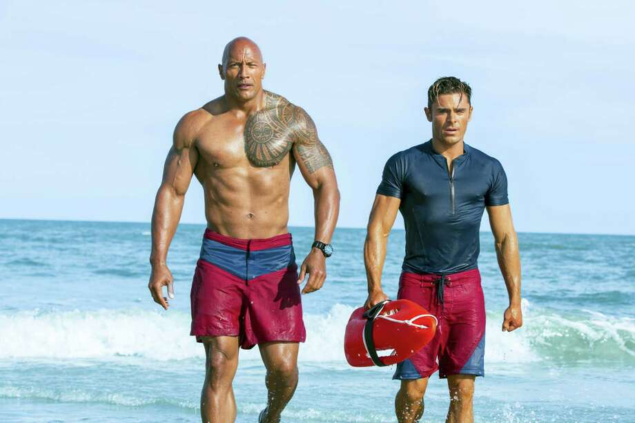 "This image released by Paramount Pictures shows Dwayne Johnson, Left, and Zac Efron in a scene from, ""Baywatch,"" in theaters May 25. (Frank Masi/Paramount Pictures via AP) Photo: AP / © 2016 PARAMOUNT PICTURES.  ALL RIGHTS RESERVED."